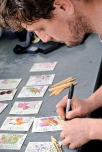 On each marker, Ryan writes the seed variety, so he's ready to place it in the trays after planting the seeds. It's also helpful to put the date of planting on the back. When ordering seeds, be sure to read the hardiness of a plant first - it will say in the seed catalog. And, know your hardiness zone, so you can select the right seeds for your area. Here in Bedford, we are zone-5.