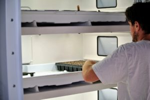 Ryan places these trays into our Urban Cultivator growing system - it has water, temperature and humidity all set-up in this refrigerator like unit. http://www.urbancultivator.net
