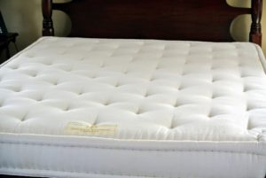 This is my mattress - it is custom made because my bed is slightly smaller than a standard Queen. A regular Queen sized bed mattress measures 60-inches by 80-inches. My bed mattress measures 57-inches by 76-inches.