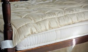 A pillow top should be treated like an extension of the mattress. It should never be washed in a machine or immersed in water. And, only use a nontoxic spot cleaner if necessary.