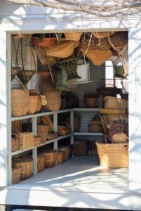Inside, I have many, many baskets - some I've purchased at tag sales, or from basket weavers. A good number of these baskets were used during my catering days.