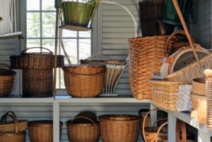 "Baskets are made using different techniques, such as ""plaiting"", which uses materials that are wide and braid like,""twining"", which uses materials from roots and tree bark. Twining refers to a weaving technique where two or more flexible elements cross each other as they weave through the stiffer spokes.""Wicker"" basketry uses reed, cane, willow, oak. ""Coiled"" basketry uses grasses and rushes."