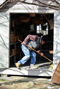 Once all the baskets were wiped and cleaned, Carlos gave the basket house a thorough mopping.