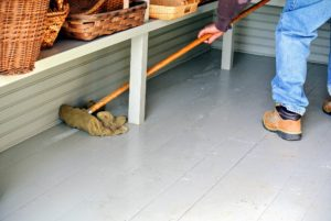 Carlos wiped the surfaces in stages - cleaning a section and then returning some baskets before cleaning another area.