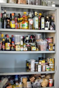 Slowly, each shelf was emptied out onto the counter. As items are moved, heed expiration dates; otherwise, most canned and bottled goods, such as preserves, pickles, and relishes, can be kept, unopened, for up to one year.