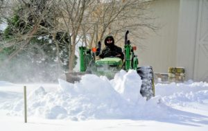Winter Storm Stella dropped 13.7-inches of snow here in Bedford, New York. Here is my outdoor grounds crew foreman, Chhiring, using our trusted tractor to move snow from the back of our Equipment Barn.