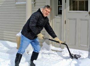 Here is Fernando shoveling another section of this courtyard. When shoveling, remember to always bend at the knees and lift with your legs - this helps to reduce back strain.