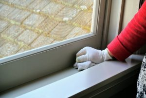 As well as the window sill, head and jams - here, Sanu wipes the sill with a damp cloth.