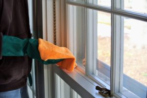 And then he wipes the pane again with a microfiber or lint-free cloth to prevent streaks.