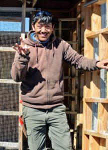 Dawa, who cares for all our outdoor avian friends, visits the pigeons twice a day to check on their food, water and well-being. Here he is with a newly laid pigeon egg.
