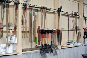 All the garden tools are hung on sturdy hooks.