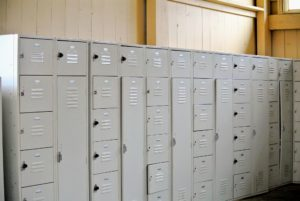 This bank of lockers is for the crew. Everyone has their own set of lockers, where they can store extra shoes, clothing, and other personal items.