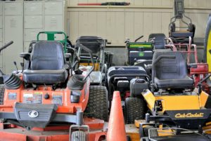 Mowers are all parked neatly together and ready to use.
