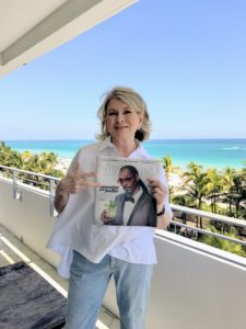 """Here I am holding a copy of the """"Miami New Times"""" with my friend, Snoop Dogg, on the cover. Snoop was also at SOBE for a culinary demo with Guy Fieri, and to host a custom """"Gin & Juice"""" bar."""