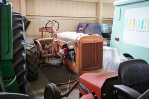 Next to the John Deere tractor, and protected with a sheet, is this vintage Allis-Chalmers tractor from the 1940s.