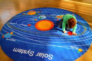 Truman loved the solar system rug.