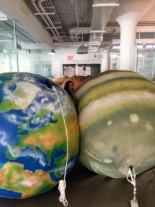 To complement the scale of the large clerestory, Alexis found giant inflatable planets that are usually rented out for trade shows. They're so big, our intern, Jenelle Belk, was nearly swallowed up.