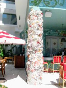 These columns in the outdoor dining area at Faena are encrusted in seashells.