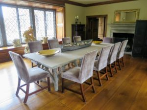 The EZ Glides are nearly invisible from this distance - they don't deter from the beauty of the faux bois dining table and silk velvet chairs.