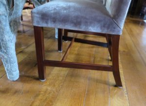 Once the chair is turned over, it is easy to push back under the table without any scratches on the floor.
