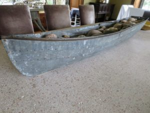 On the pink granite-topped table, even the boat, holding many stones I've collected over the years, has EZ Glides under its hull.