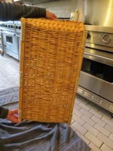 The EZ Glides stick firmly to the wicker. These baskets are pretty sizable, so Gretchen uses six strips under each basket.