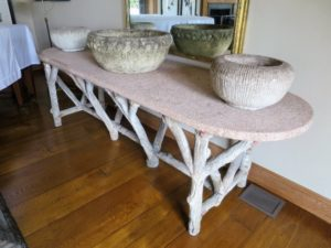 This pink granite-topped table is currently in my living room. EZ Glides are affixed to all the legs, especially since I like to move its location from time to time.