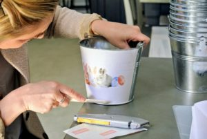 She does this for the top and the bottom of the pail to give it a finished look.