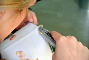 Using a utility knife, Shqipe trims off any excess.