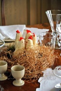 Lots of nesting chickens adorn the dining tables. Decorations don't have to be fancy - use regular Easter basket grass to make nests for all your Easter birds.