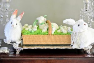 Lifelike Hansa rabbits flank an Easter basket given to me by Kevin Sharkey. https://hansatoysusa.com