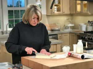 Once the dough is combined, form it into a six-inch square and cut into thirds. I form the dough in a piece of parchment paper. Watch the show to see how easy this is to do.