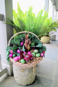 Kevin Sharkey makes me an Easter basket every year. Here is this year's - it's so pretty sitting out on my porch. Please follow him on Instagram @seenbysharkey
