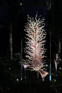 This is White Tower with Pink Fiori. This installation was made in 1997 in the Czech Republic. Chihuly mixed iridium—an elemental metal—into the glass's silica and sand. And, because iridium is illegal to import to the United States, the tower had to be fully finished abroad before it could be brought to America.
