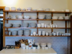 This is my 'Great Wall of China' - four open shelves that span nine-feet across one kitchen wall at Skylands. I created it by taking every white dish I could find out of the cupboards and putting them on display.
