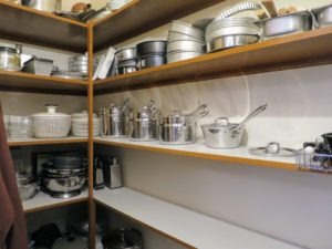 I keep the pots conveniently located to the right of the cooking area in what I call the cookware pantry.