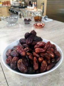 These are Medjool dates, the most available dates grown in the United States. Medjool dates can be consumed fresh or dried, and are known to lower cholesterol and boost energy. They were used to sweeten our flatbread recipe.