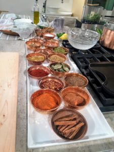 On the counter, we display all the different spices we use during the show, such as coriander, chili powder, mustard powder, paprika, caraway, cinnamon and more.
