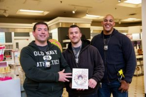 These police officers had such a fun time at the demo and book signing - they also purchased books. (Photo by Richard Allsopp for Macy's Inc.)