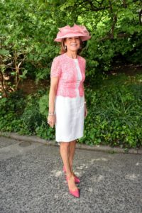Anne Harrisson is a former President of the Women's Committee and past honoree of the Frederick Law Olmsted Award. She is wearing a lovely pastel pink hat. (Photo courtesy of BFA.com)