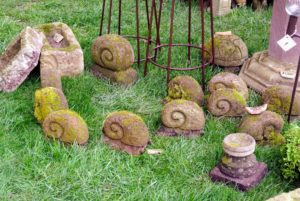 Here is a group of snail garden ornaments.