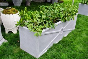 They're made of pummeled stone and marble blended with resin, which help make them so lightweight. Learn more about them on a previous blog. http://www.themarthablog.com/2015/10/garden-pots-and-planters-from-pennoyer-newman.html