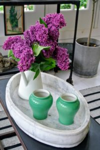 A lovely vase of fresh lilacs adds such wonderful spring color to this table.