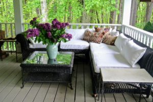 On the porch is a very inviting space with a large, comfortable sectional for cool summer evening chats.