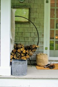 Also on the porch is a stack of wood for the fireplace - everything is so charming and cozy.