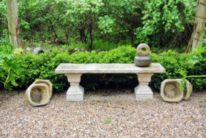 This stone bench sat nearby. Flanking it are more of Patsy's beautiiful stone vessels.