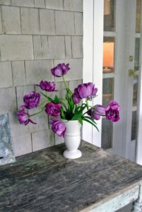 On a rustic wooden table on Patsy's expansive wrap around porch is this vase of tulips - it adds just the right amount of color.