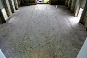 The wooden floor is also completely free of debris and shavings.