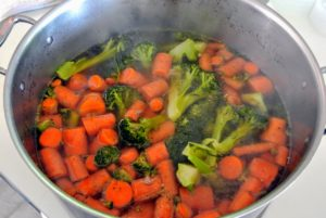 The carrots and broccoli are done - They are chopped up and added to the bowls.