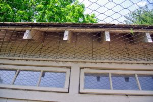 The edges are held secure between wooden slats - every inch of the enclosure is protected.